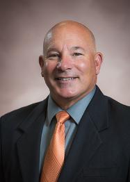 Head shot of Mayor Ron Alt, looking forward, smiling