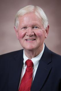 Head shot of smiling Lewis George, Town Administrator