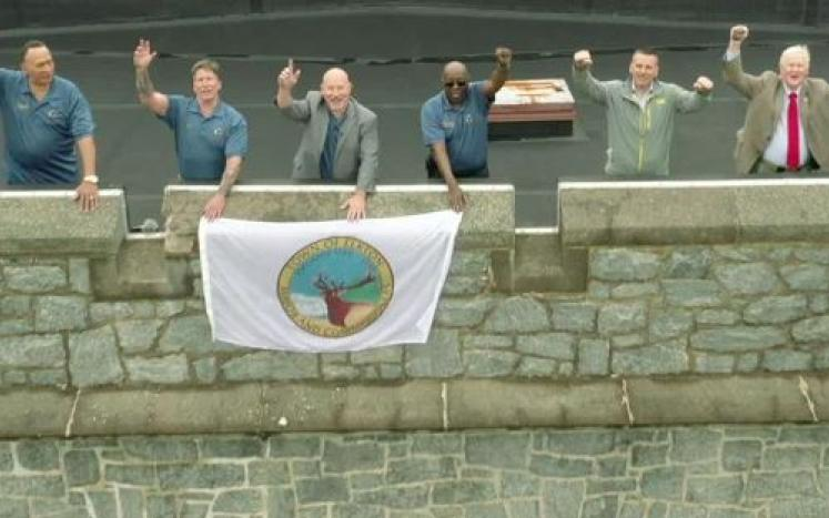 Image of Mayor and Commissioners and Town Administrators atop the Elkton Armory